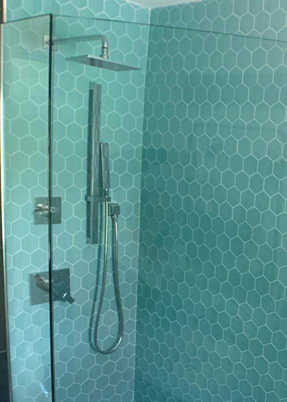 Closeup of shower in tiled shower area